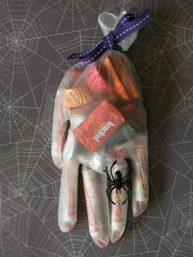 Fill a latex glove with candy and top it off with a spider ring for a fun Halloween treat