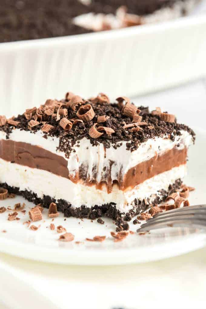 chocolate lasagna with a bite out of it