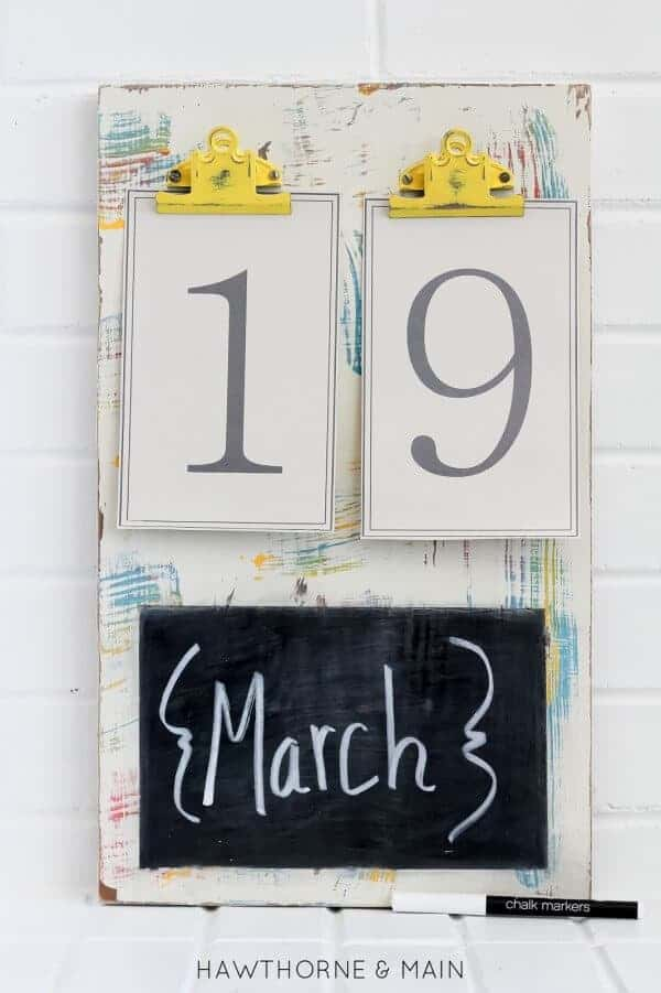 Chalk board with yellow clips 9