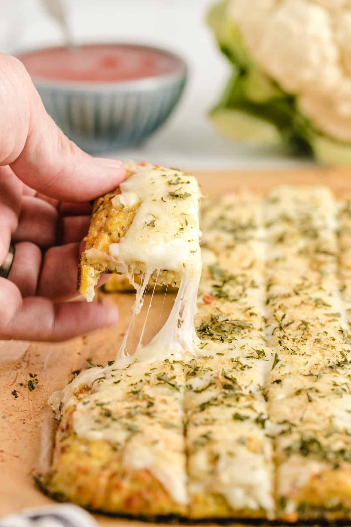 Cheesy Cauliflower Bread Sticks cheese pull