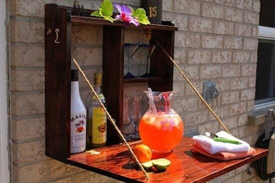 Build a backyard bar - this fold away bar will be great for serving and space saving!