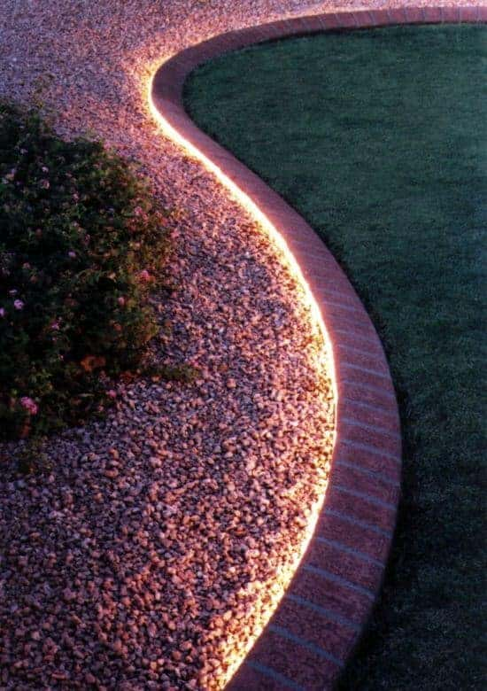 Use rope light to line walkway or edging. Not only is this great to create an illuminating ambience that will make your backyard glow, but it is also great for safety at night!