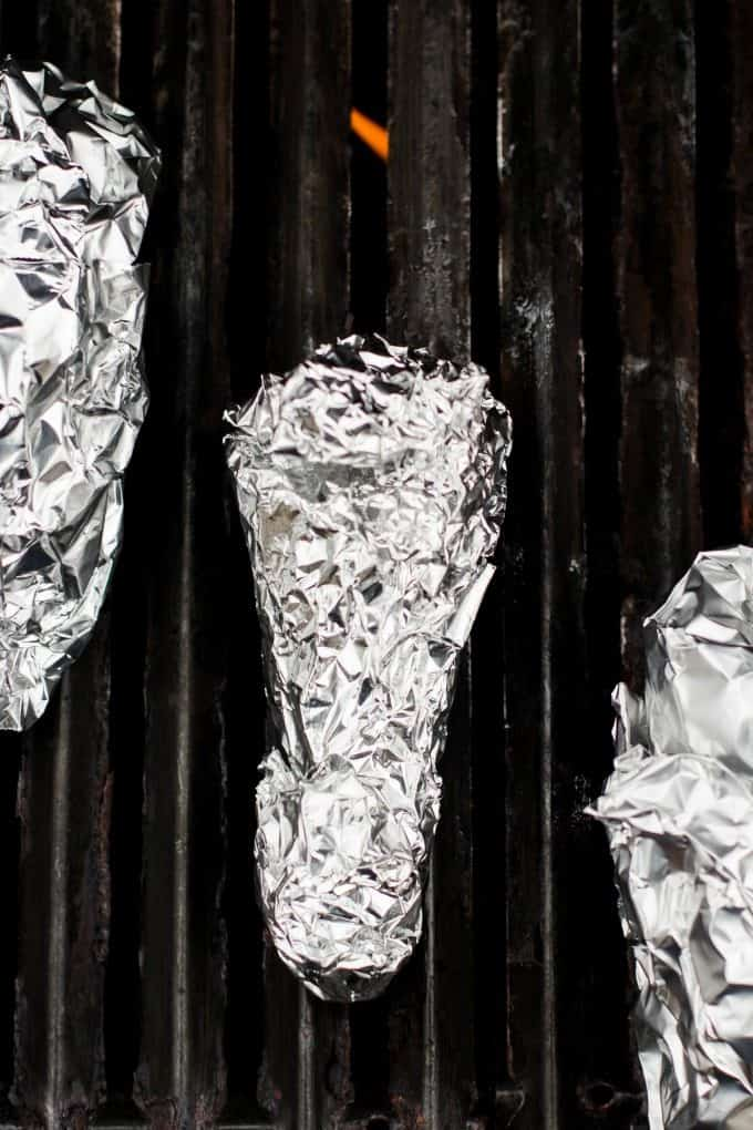 campfire cones wrapped in foil and placed on grill