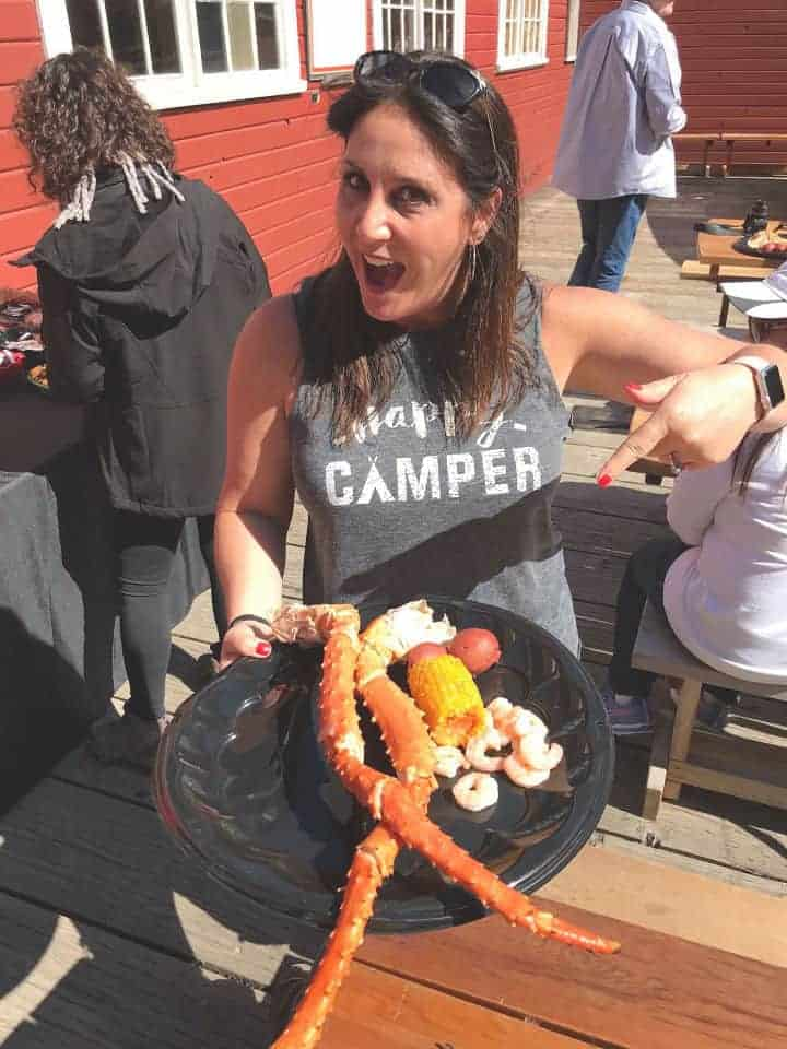 Girl pointing to a plate of crab legs
