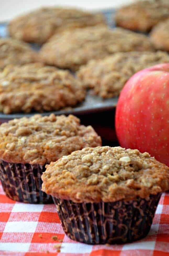 These Apple Muffins with a crumb topping are not only delicious but will make your house smell amazing. The fresh apples, allspice, and cinnamon in these muffins are perfect for fall.