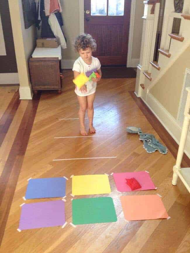 Make your own indoor bean bag toss game - great rainy day activity