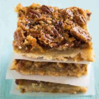 pecan pie bars stacked in three