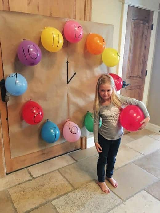 New Year's Eve Ideas for kids - pop a balloon every hour from Toddler Approved