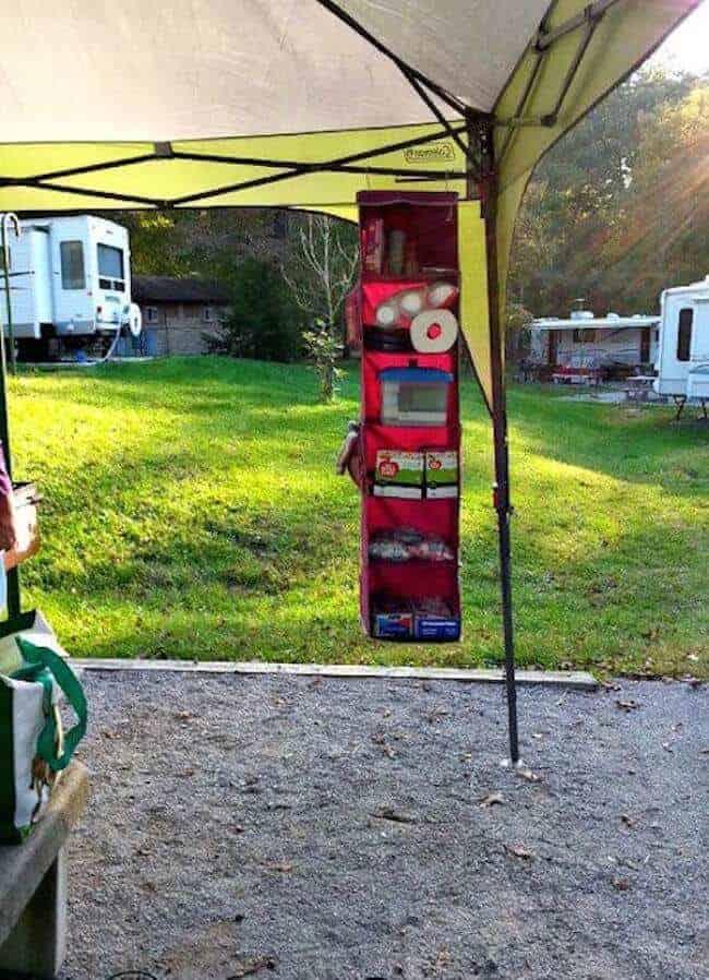 Use a shoe hanger when you go camping to organize supplies