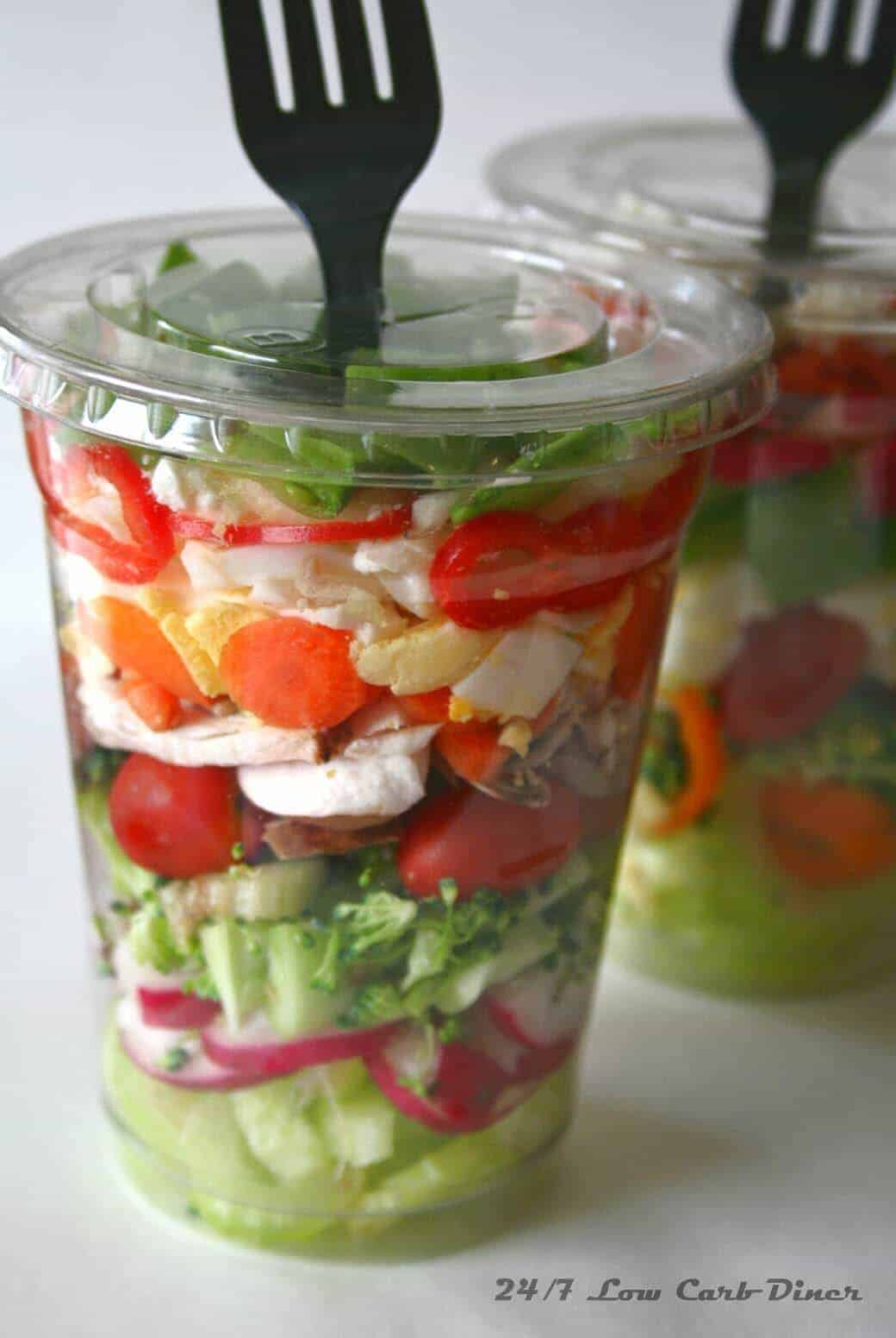 Chopped Salad in a Cup from 247 Low Carb Diner - what should you serve for a large crowd at your party? This is an easy grab and grow food for a crowd and other genius party hacks and tips