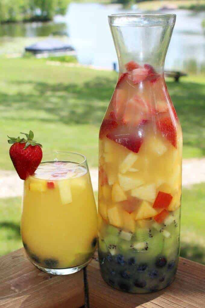 Rainbow Sangria brings the delicious tastes of Spain right to your backyard. The perfect drink to serve at a summer party. It is cool, refreshing and beautiful!