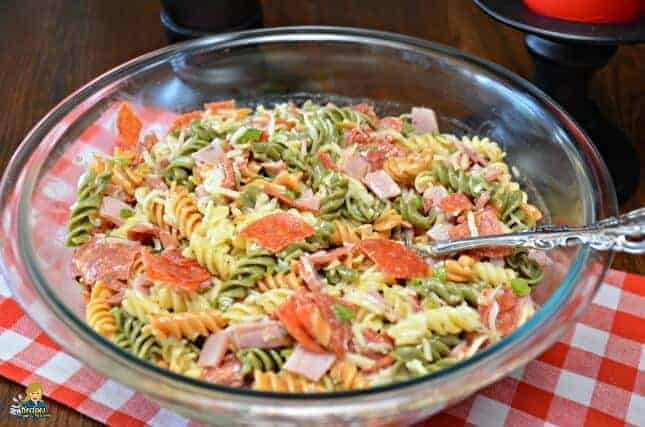 Pizza pasta salad in a glass bowl