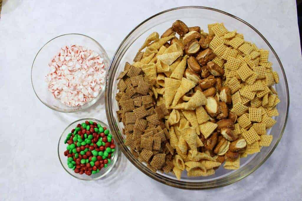 Chex Mix recipe Dry Ingredients - mini m&m's, starlight peppermints, pretzels, bugels