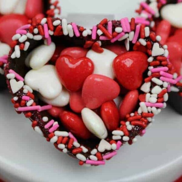 Chocolate heart bowl for Valentine's Day filled with pink and red and white candy