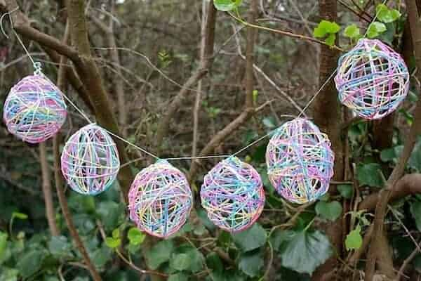 Yarn Easter Egg Garland via Mod Podge Rocks | The Coolest Easter Egg Ideas
