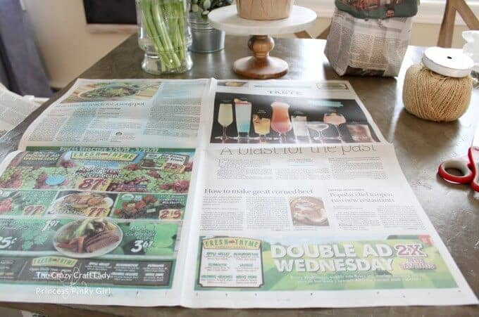 Make these simple yet elegant newspaper spring planter bags for your bulbs and greenery. This is a GENIUS way to decorate for spring with fresh flowers!