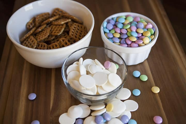 Ingredients needed to make Flower Pretzels - buttersnap pretzels and candy melts and pastel M and M's