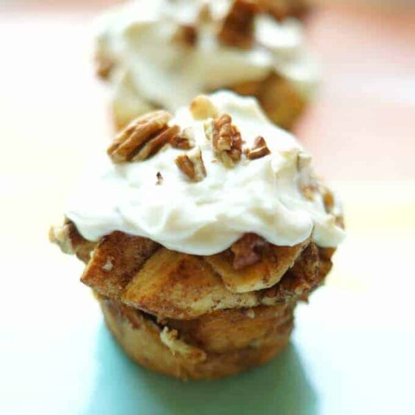 Delicious Cinnamon Roll Muffins with Pecans and Tangy Cream Cheese Frosting