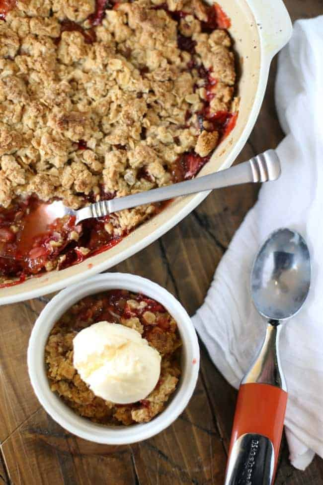 Deliciously simple Strawberry Crisp, this recipe has been in our family for years! It's the perfect recipe for a BBQ, potluck or just dinner at home!