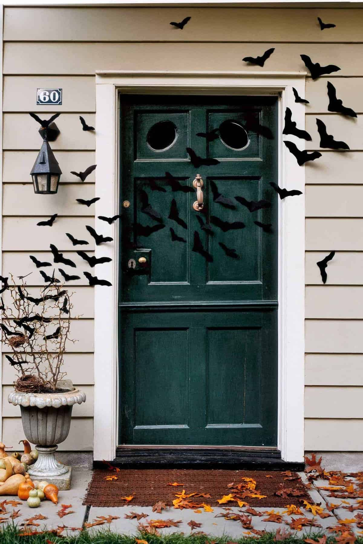 Bat Filled Door Via Country Living | and other great Halloween Door decorations
