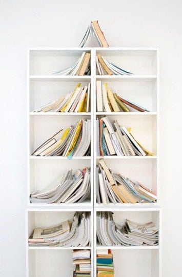 Book Tree via Apartment Therapy | Totally cool and unique Christmas tree ideas!