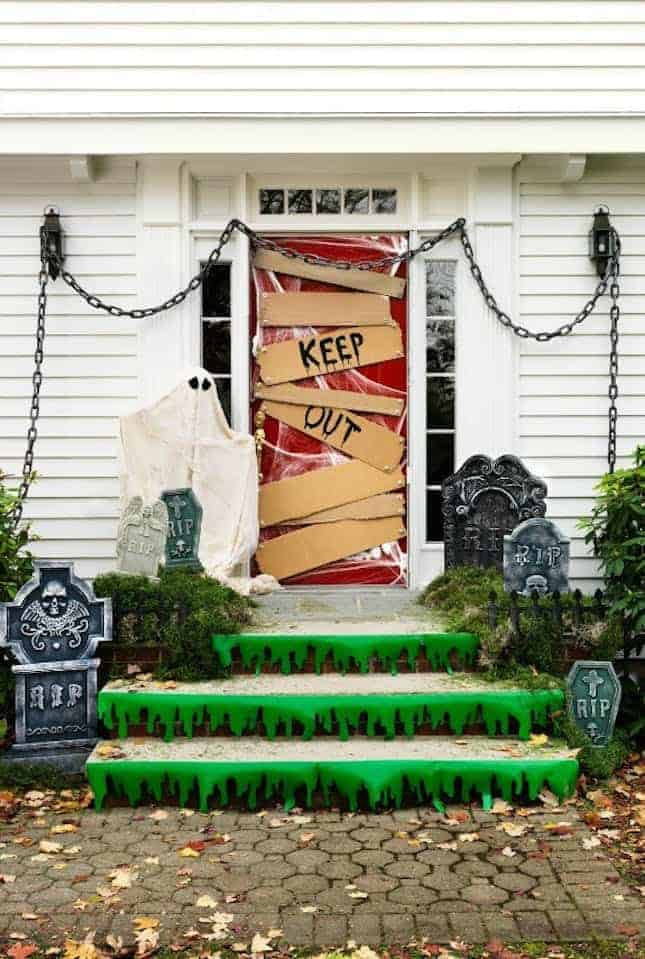 Ghostly Graveyard via Women's Day | and other great Halloween Door decorations