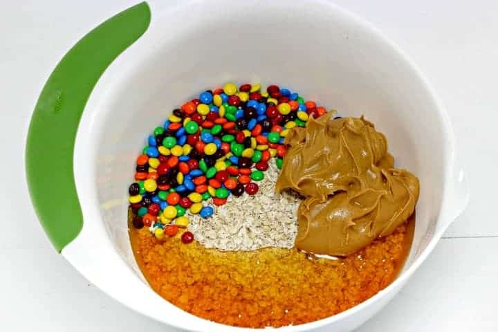No Bake Oatmeal Energy Balls place all ingredients in a large bowl
