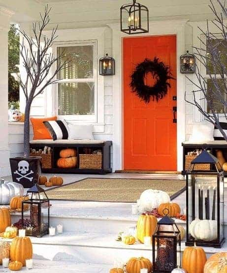 Orange Front Door via Babble | and other great Halloween Door decoration ideas