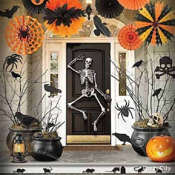 Skeleton Front Door via Party City | Frighteningly Fun Halloween Door Ideas