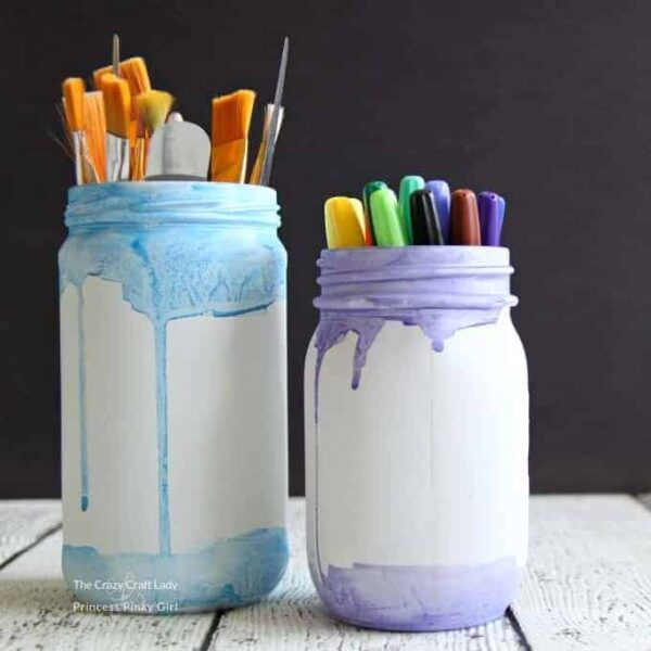 These watercolor mason jars are the perfect solution for storing painting and craft supplies, or to use as a simple vase for fresh flowers. I love simple and easy mason jar crafts!