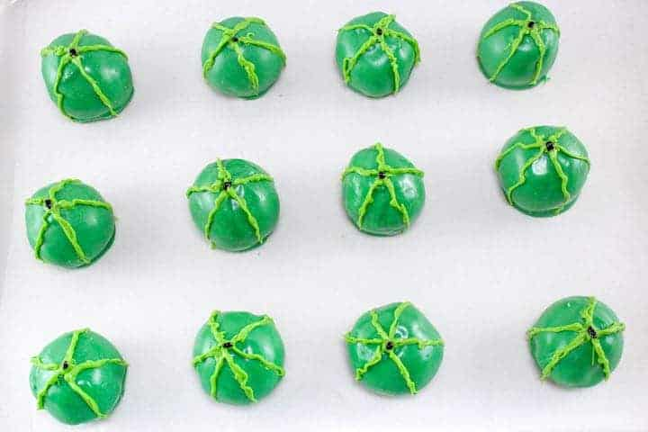 let your Watermelon Cake pops dry and use green candy coating to decorate