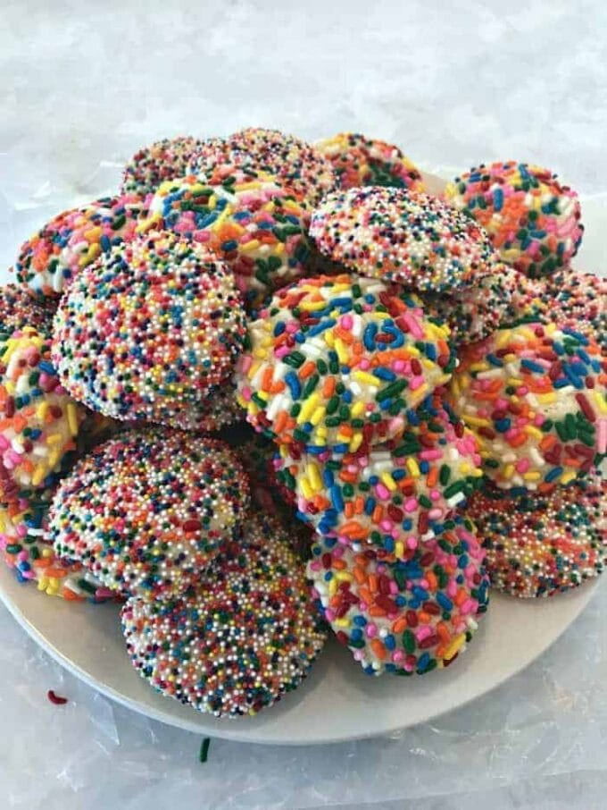 Rainbow Sprinkle Cookies - Delicious sugar cookies that are soft and chewy covered with baked on sprinkles