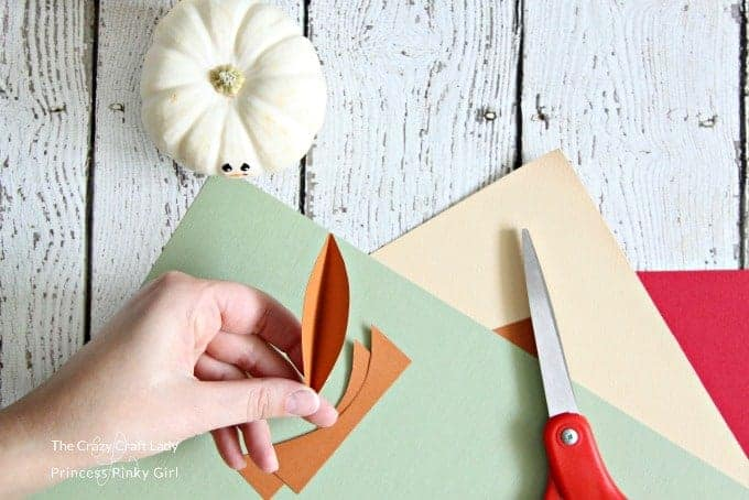 cut out feathers from construction paper for your Turkey craft