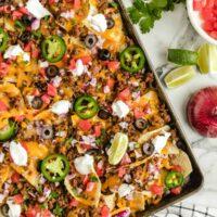 sheet pan nachos on a baking sheet