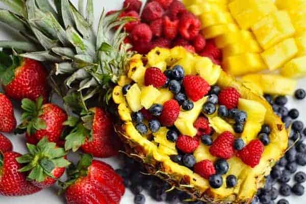 Fruit Salad in a Pineapple Boat by The Reluctant Entertainer and other great fruit tray ideas