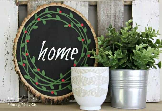 A wood sliced painted wreath makes a gorgeous modern farmhouse type of Christmas decor