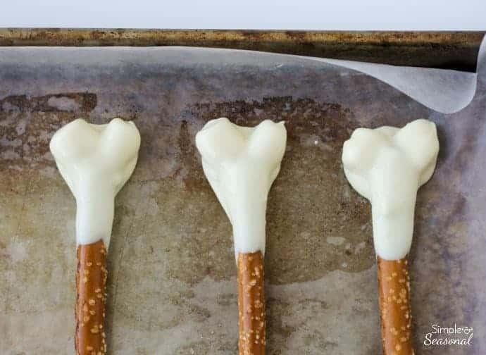 Dip the marshmallows and pretzels in chocolate