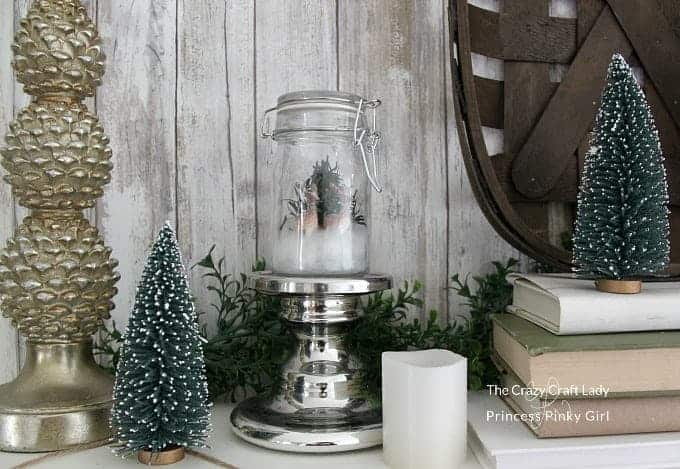 Follow this tutorial to make a DIY Snow Globe! This mini glass jar snow globe is a mason jar winter scene is perfect for Christmas and winter decor.