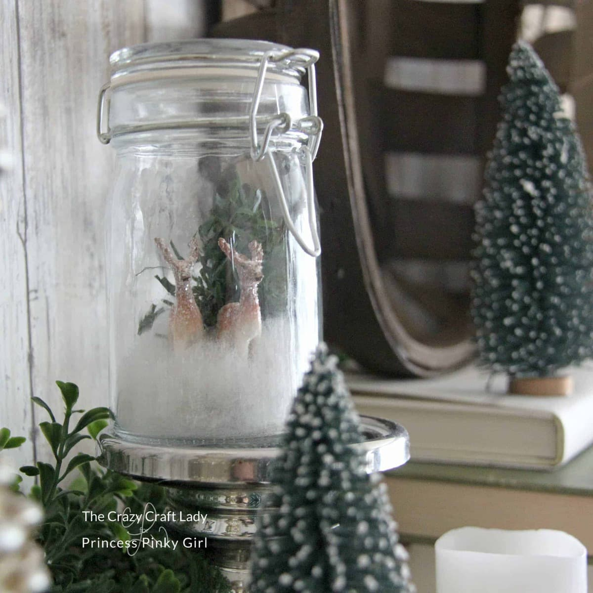 Follow this tutorial to make a mini glass jar snow globe. This mason jar winter scene is perfect for Christmas and winter decor.