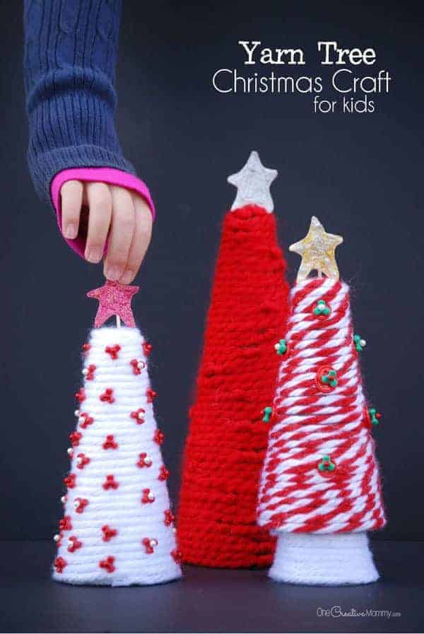 Yarn Tree Christmas Craft idea by One Creative Mommy | The best ever kids Christmas Craft Ideas. So many fun ideas to get the kids involved in the holiday fun!
