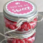 "Use this free printable and make ""You're So Sweet"" Valentine candy jars. This simple mason jar craft is the perfect Valentine's Day treat to share with teachers, co-workers, and friends."