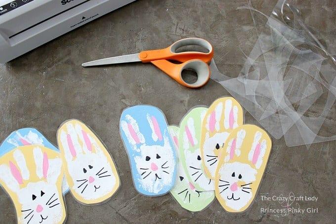 Laminate the bunny hand prints