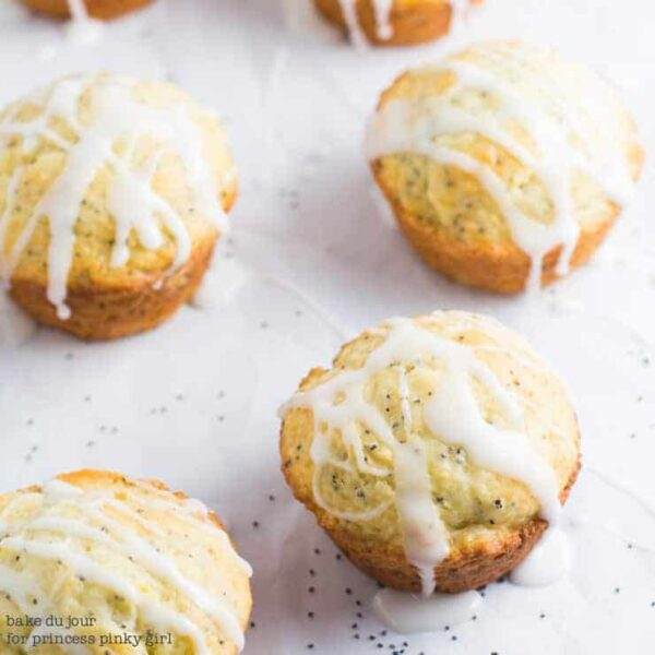 A batch of Lemon Poppy Seed Muffins topped with a lemon glaze