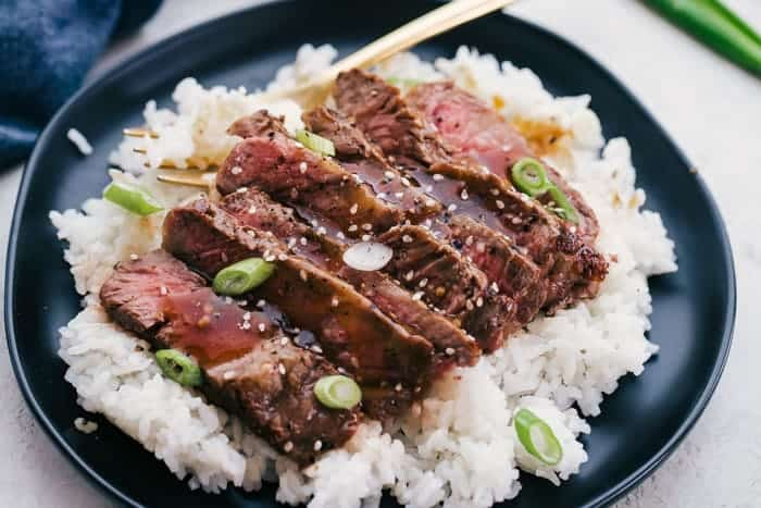 Rib eye steak recipe on white rice