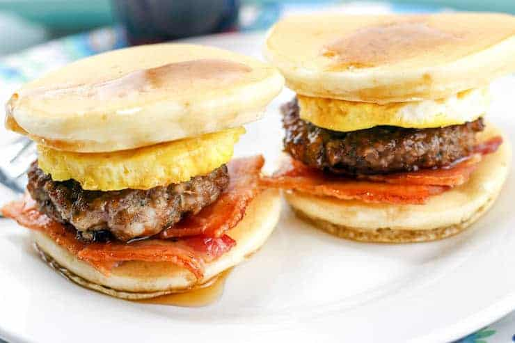 Pancake breakfast sliders - Pancake, egg, sausage and bacon stacked on a plate