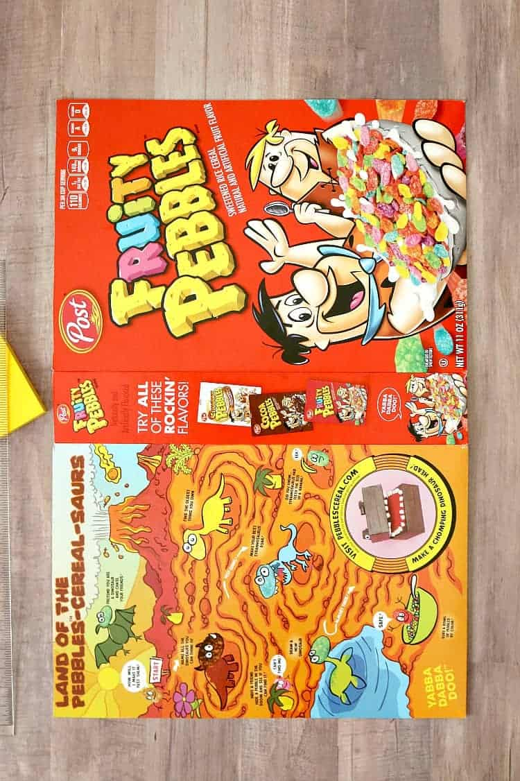 Lay the cereal box flat and trim the edges