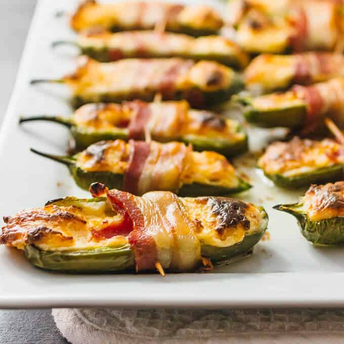 Bacon Wrapped Jalapeno Poppers by Savory Tooth | Delicious entertaining recipes and party food ideas you will want to make!