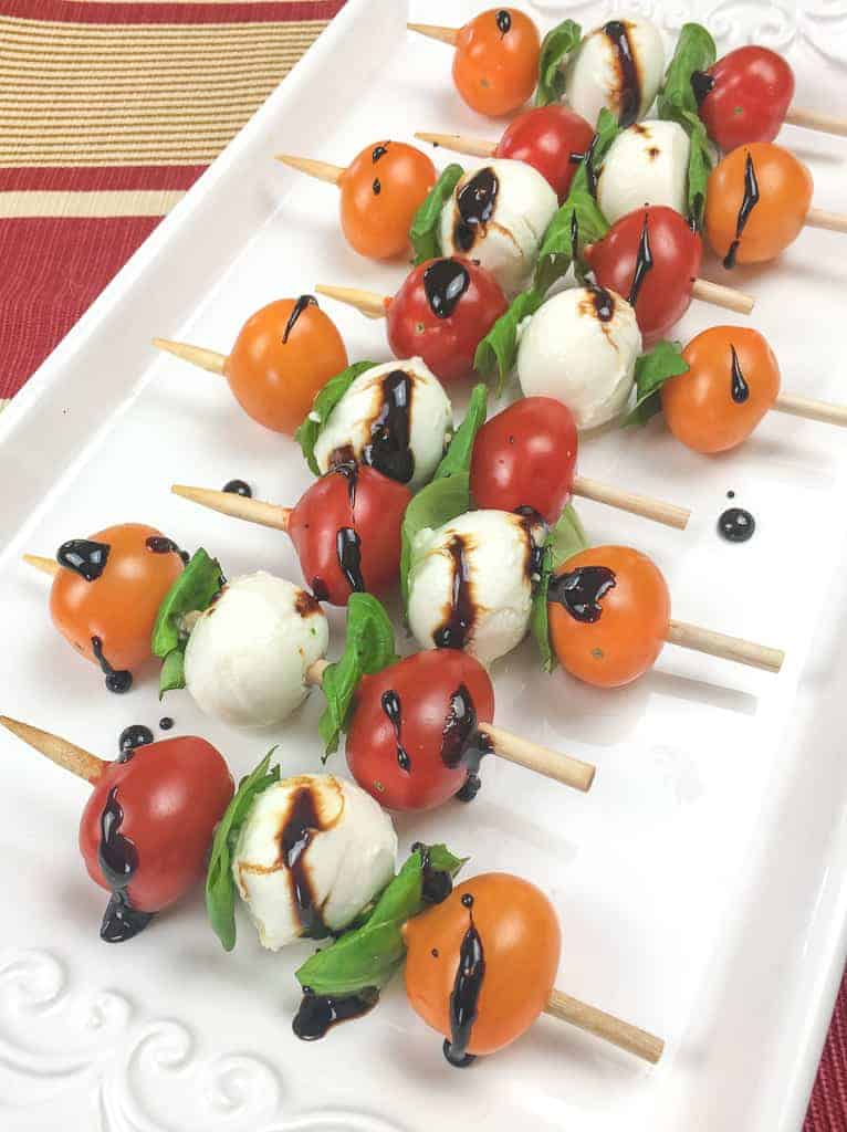 Easy Caprese Salad Skewers with Balsamic Glaze by The Zesty Olive | These recipes are just perfect for summer entertaining!
