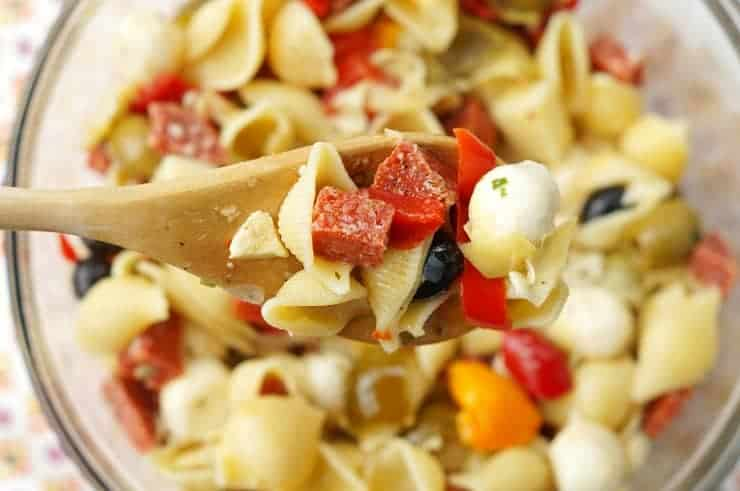 Mix pasta, salami, tomatoes, peppers, cheese and dressing together to make The Easiest Antipasto Pasta Salad Ever!