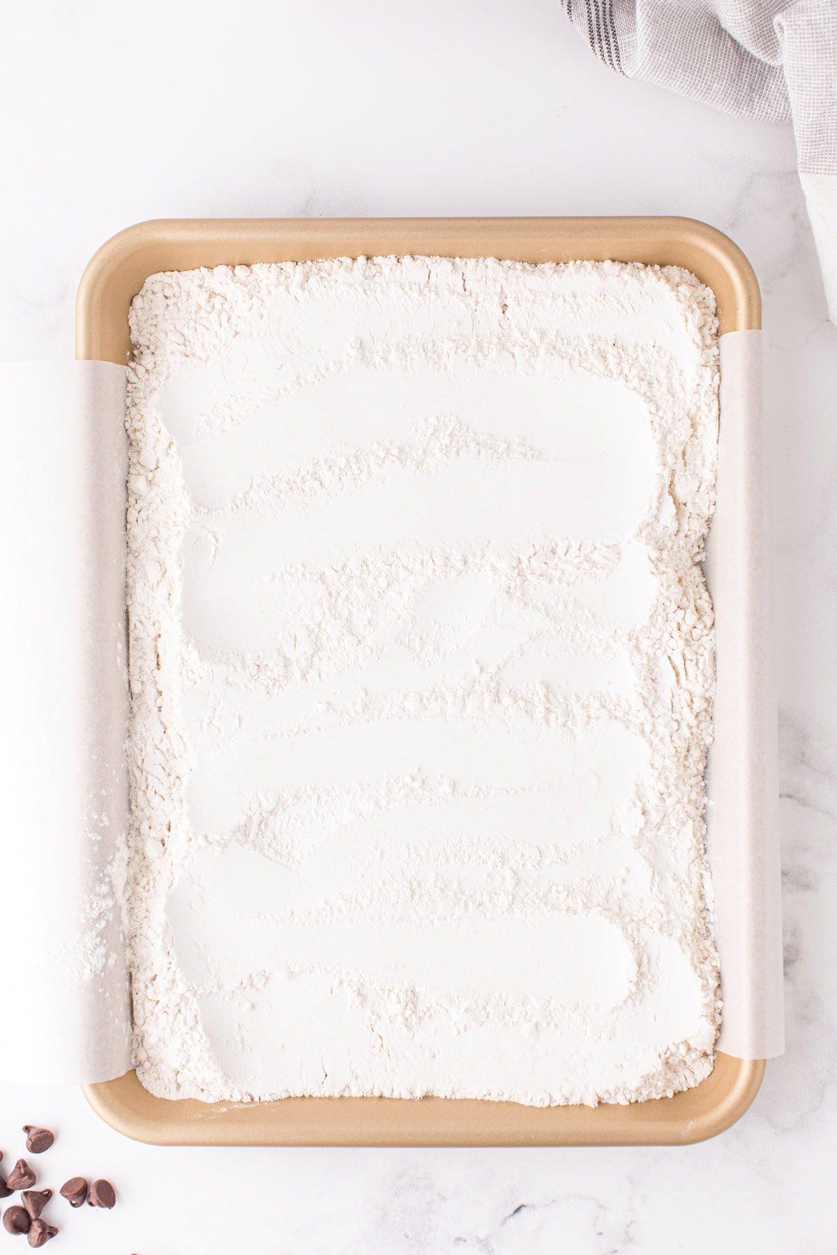 flour in baking pan